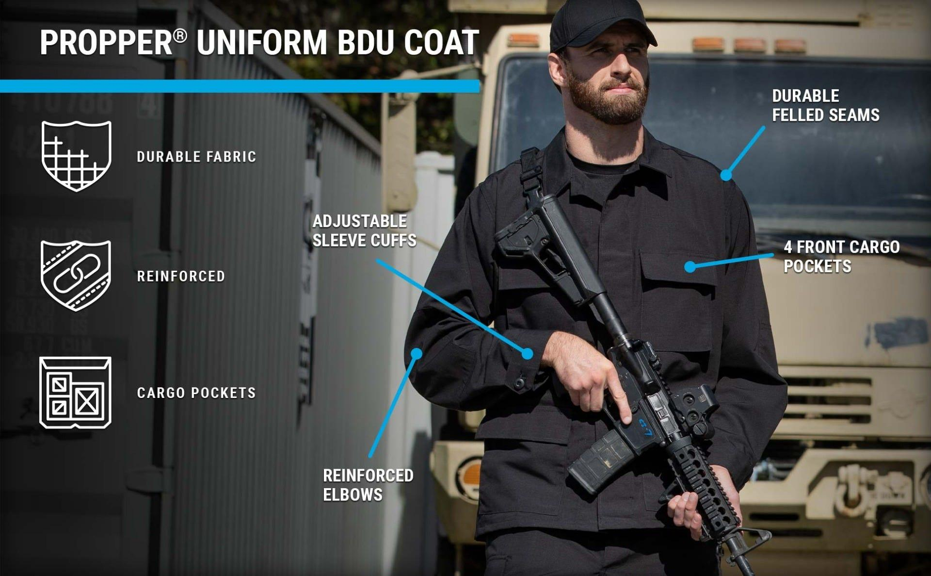 Man holding rifle in black BDU coat featuring 4 front cargo pockets & adjustable cuffs