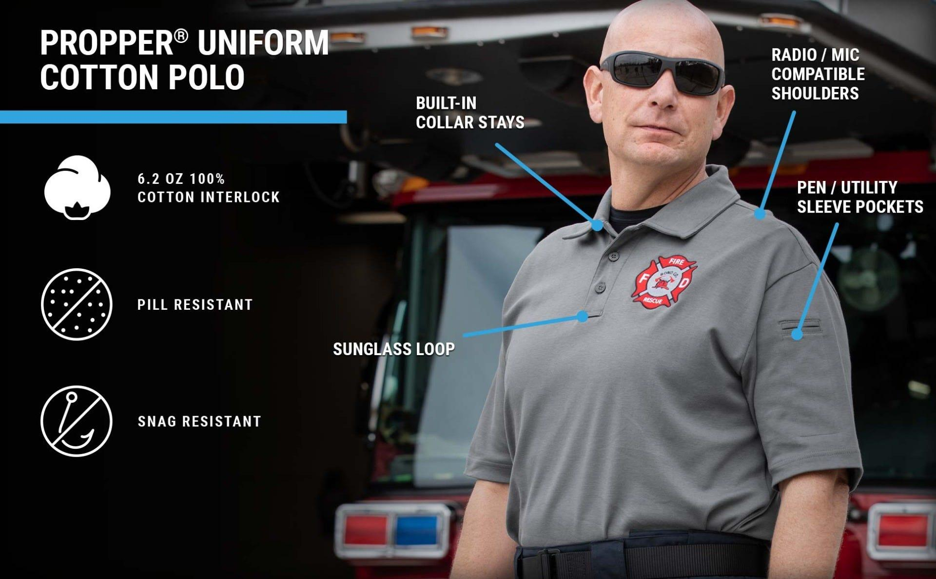 100% soft Cotton uniform polo on a firefighter with collar stays, mic clip, pen pocket won't melt or drip in fire.